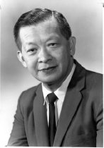 Image of Dr. Tjio in a formal portrait with dress tie and suit