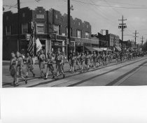 Image of 2006.13.1.9.21 - Girl scouts in Memorial Day parade 1949.