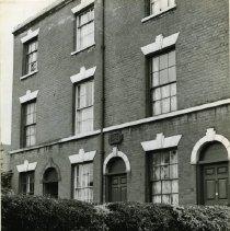 """Image of A 6.25""""x8.25"""" black and white photograph of 12 Notintone Place, the birthplace of William Booth.  A plaque commemorating the site is visible above the door."""