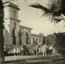 """Image of This 3.5""""x5.5"""" postcard features a black and white photograph of a group of boys and girls saluting as an American flag is raised by two young boys.  A Salvation Army officer stands with the children.  The group is standing in front of a large white building.  There are two palm trees in the foreground.  The caption on the front reads, """"TEACHING PATRIOTISM AT LYTTON, CAL. SALVATION ARMY HOME FOR CHILDREN.""""   The back of the card reads, """"POST CARD,"""" at the top.  Below this, the card is divided into halves, the left side labeled, """"CORRESPONDENCE,"""" and the right side labeled, """"ADDRESS ONLY."""""""