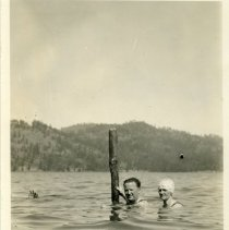 """Image of A snapshot of two people in the water, heads and shoulders exposed.   Captioned """"Major and Mrs. Fristrup up to their necks in water.  Camp Cougar 1930"""""""