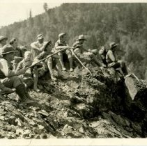 Image of Snapshot of boy scouts resting on a ledge overlooking a canyon.