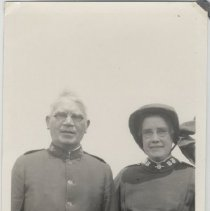 Image of A snapshot of two unidentified Salvation Army officers. Man and woman.
