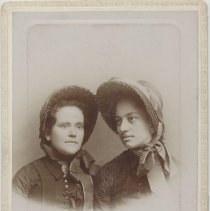 Image of A portrait of two female adults in Salvation Army officer uniform.  identified as Captains Walker and Keness.