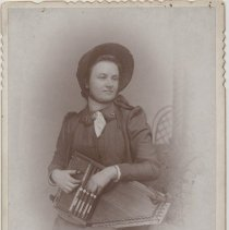 """Image of A portrait of a female in Salvation Army uniform, holding an autoharp or zither. On the back is written """"Capt. Boyles  sweet voice, on the Staff"""".  Taken in Ottawa, IL."""
