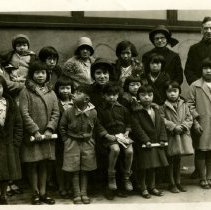 Image of Chinatown Sunday School class picture with Ensign Connie Sly.  Two unidentified officers are also in the picture.  Probably San Francisco Chinatown, but nothing to confirm is written on the photo.