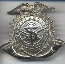 Image of A silver band-hat pin featuring an eagle, the logo and mantra and two horns. -
