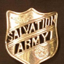 Image of A metal pin of the Salvation Army shield. -