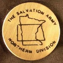 """Image of A circular pin with the outline of the states of Minnesota and North Dakota and a inscrpition """"The Salvation Army Northern Division."""" -"""