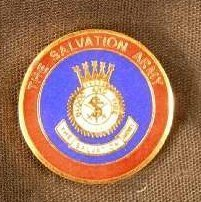 Image of A red and blue circular pin with the crest of the Salvation Army. -