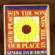 """Image of A rectangular pin which advertises the arrival of General Eva  Burrows to Kansas City in October 1992. There is an inscription  which says """"Our Place in the Son"""" around an sunflower. -"""
