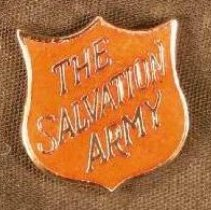 Image of A pin in the shape of the Salvation Army crest. -