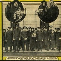 Image of News clipping from the War Cry of Commander Evangeline Booth on her arrival at Oakland, California being greeted by Commissioner Adam Gifford and leading Staff Officers.  In the inset of the news clipping are two oval pictures placed at the top.    The oval insert on the left side is of Evangeline Booth holding a floral bouquet and waving.  The oval inset to the right is Evangeline Booth with a floral bouquet and Commissioner Adam Gifford  standing next to Commander Booth.