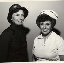 "Image of A digital copy of an 8x10, B&W photograph of Comm. Gisele Gowans and Major Joy Church, both in costume for the musical ""Glory"".