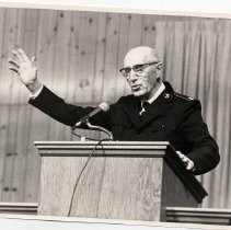 Image of A digital copy of an 8x10, B&W photograph of Comm. Glenn Ryan making a speech during camp meetings at Redwood Glen.
