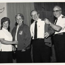 Image of A digital copy of an 8x10, B&W photograph of Comms. Joan and Anrew Miller meeting Col. Ray and Bunty Robinson. 