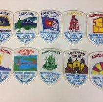 Image of A set of patches, one from each Western Territory division, made for the 1980 National Centennial Celebrations.  -