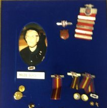 Image of A pin collection sumamrizing the achievements of Maude Burdette, which includes several Home League pins, Sunday School pins, service recognition pins and other decorations.  -