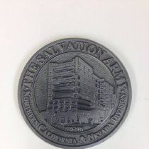 """Image of A commemorative metal coaster marking the redesignation of the """"Northern California and Nevada"""" division into the Del Oro and Golden State divisions.  - 1995"""