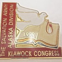 """Image of A pin with a dove and bible with the words, """"The Salvation Army Alaska Division Klawock Congress 1999."""" - 1999"""