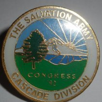 Image of A circular pin with the sun, mountains, water and a tree. This pin is from the 1992 Western Territory Congress, Salvation Army's Cascade Division . - 1992
