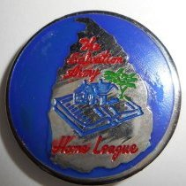 Image of A circular pin from the Salvation Army Home League. -