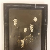 Image of A small white photograph with a family of what looks to be a family of Japanese Salvationists.  -