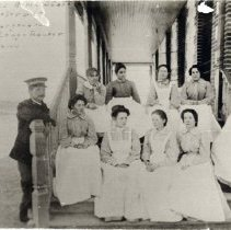 Image of A B & W photograph of Cherry Tree Home staff.   Far left, Captain Jos. Hargreaves. Mrs. Captain Hargreaves, and teacher Alice Long.