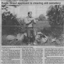 Image of Eagle Scout applicant is clearing old cemetery