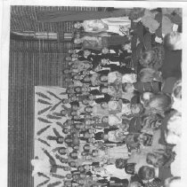 Image of Tiny Tot wedding at Lincoln School, sponsored by PTA.  Newspaper article pasted on back of photo identifies the cast of characters. -