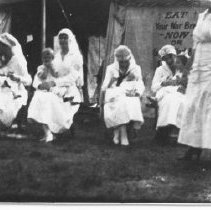 Image of Nurses holding children - 1910 - 1930 - Thomas J. Campbell Collection