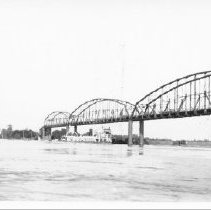 """Image of """"The 'Franklin Roosevelt' en route from St. Louis to Kansas City, passing under the Rte 40 Bridge at the crest of the flood."""" - Flood June 1935 - Flood June 1935"""