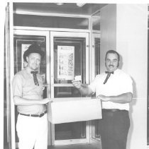 "Image of Two men holding ""The Winner Is""  1969 - Arlen Gibson Collection"