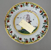 Image of 1967.001.056 - Dish, Faience/ Delft, Polychrome dish in yellow, green and red on gray white background with man with wig.