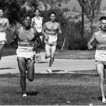 """Image of 1991 Cross Country Running 1 - """"10/1991 - X-Country: Marty Doyle, Mike Murphy, Tim Vandeivlught (front, right), Rich Wiebe (back, left)"""""""
