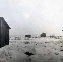 "Image of 1913 Oregon, Homestead - ""1913 - Xmas Day""  This is a picture of an early Oregon homestead taken on Christmas day.  The snow is deep, and the buildings are set far apart.  The house is in the distance, third building from the left."
