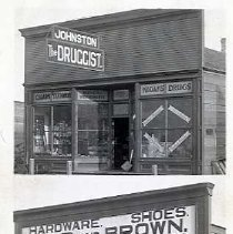"Image of 1910+/- Oregon, General Stores - Two general stores are pictured here.  They are, ""Johnston, The Druggist.""  Selling, ""Cigars, Stationery, Musical Instruments, Books, Kodaks, and Drugs""  And, ""Gibb and Brown"" Selling, ""Hardware, Shoes, Dry Goods, and Groceries."""