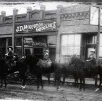 "Image of 1900+/- Oregon, Street Scene - A man, and two women riding side-saddle have stopped their horses in front of ""J.D. McKennon Groceries."""