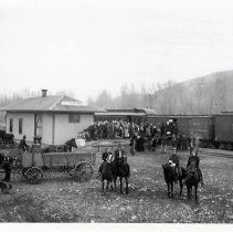 "Image of 1912 Lostine, Elk Cargo - ""Mar. 1912, Lostine Crowds.  The little town of Lostine, at the foot of the the famous Eagle Cap Wilderness area, turned out enmasse to view the boxcar of elk on their way to the northeastern corner of the state of Oregon."""