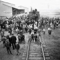 "Image of 1912 Wallowa, Elk Cargo - ""Mar. 1912, Crowds visiting Elk at Wallowa.  The scene at Wallowa was typical of stops near Baker and at La Grande, Elgin, Wallowa, Lostine and Enterprise.  Schools were dismissed for a half-day to permit students to join the throngs viewing the big elk along their route of travel."""