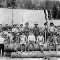 "Image of 1900+/- Oregon, Saw Mill 1 - ""Elgin area? logging""  This is a portrait of the rough men who worked as loggers in the early 1900's.  They are posed on a large log pile."