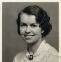 """Image of 1933 Alumni, Maybelle Romig - """"1933 - Maybelle Romig, Charter Years, c. 1929-1939""""  This is a portrait of Maybelle Romig wearing a light colored, collared blouse with a dark brooch at the neck."""