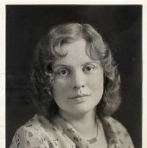 """Image of 1931 Alumni, Grace Herr - """"Class of 1931 - Grace Herr, Charter Years, c. 1929-1939""""  This is a portrait of Grace Herr wearing a light colored, floral patterned, blouse, and a necklace."""