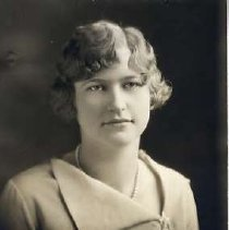 """Image of 1930 Alumni, Abbie McMurren - """"1930 - Abbie McMurren, Charter Years, c. 1929-1939""""  This is a portrait of Abbie McMurren wearing a light colored, one side collar, blouse, and a pearl necklace."""