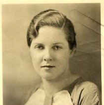 """Image of 1934 Alumni, Virginia Wetzel Lewis - """"1934 - Virgina Wetzel Lewis, Charter Years, c. 1929-1939""""  This is a portrait of Virgina Wetzel Lewis wearing a medium colored blouse with a large, hankie bow, collar."""
