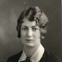 """Image of 1930 Alumni, Jeanette Medler - """"1930 - Jeanette Medler, Charter Years, c. 1929-1939""""  This is a portrait of Jeanette Medler wearing a dark colored, blouse with a white collar, dark buttons, and a dark brooch at the neck."""