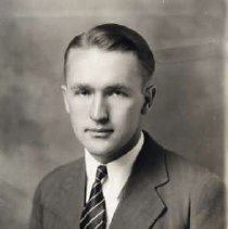 """Image of 1933 Alumni, George Peal - """"1933 - George F. Peal, Charter Years, c. 1929-1939""""  This is a portrait of George F. Peal wearing a medium colored suit over a white, dress shirt and a dark striped necktie."""