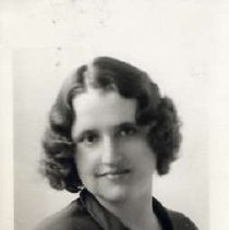 """Image of 1930 Alumni, Nida Knight - """"Class of 1930 - Nida B. Knight, Charter Years, c. 1929-1939""""  This is a portrait of Nida B. Knight wearing a dark colored, blouse with a large, slightly light colored bow at the neckline."""