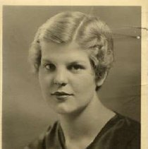 """Image of 1934 Alumni, Beverly Guye - """"Class of 1934 - Beverly Guye, Charter Years, c. 1929-1939""""  This is a portrait of Beverly Guye wearing a dark colored, silk, blouse with a draped neckline."""