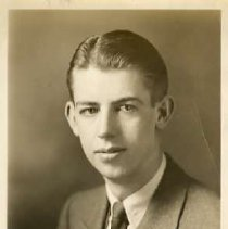 "Image of 1932 Alumni, Dallas Norton - ""1932 - Dallas Norton, Charter Years, c. 1929-1939""  This is a portrait of Dallas Norton wearing a medium colored suit over a dress shirt and dark necktie."